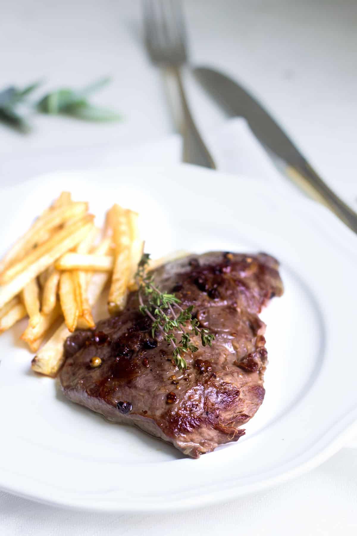 Steak Frites: A Parisian bistro favorite made right at home! Recipe via MonPetitFour.com