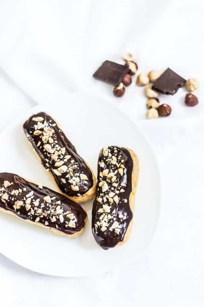 chocolate eclairs on a plate image