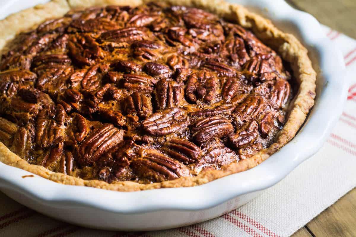 Pecan Pie - Made with an extra gooey filling and No corn syrup! Recipe via MonPetitFour.com