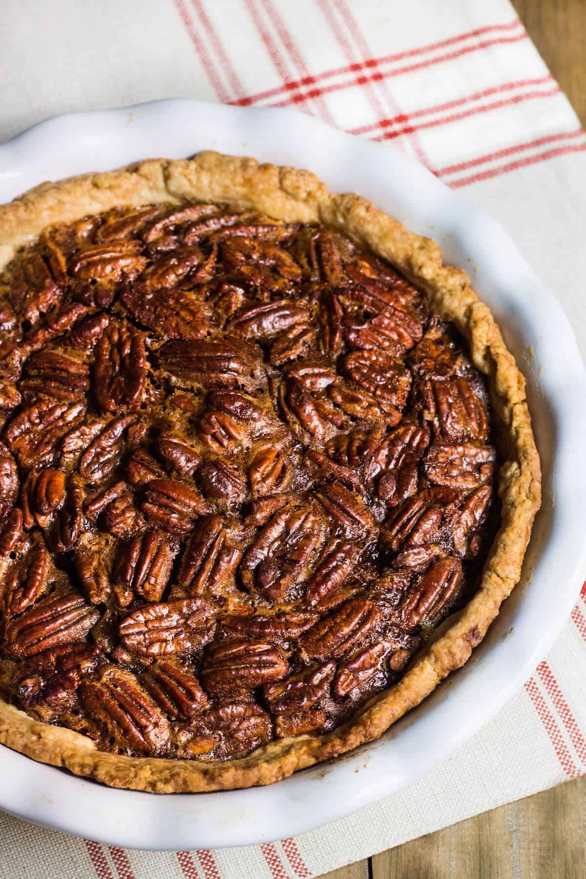 Pecan Pie - Made with an extra gooey filling and No corn syrup! Recipe via MonPetitFour.com