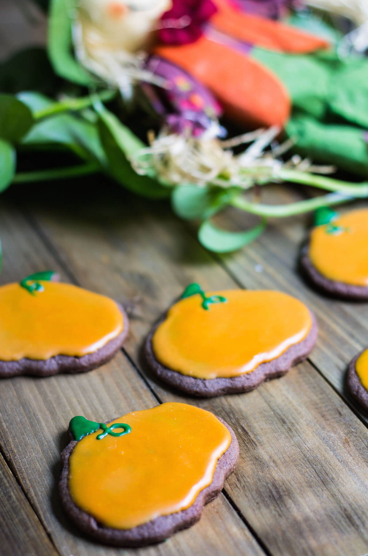 Halloween Cookies decorated as pumpkins with royal icing