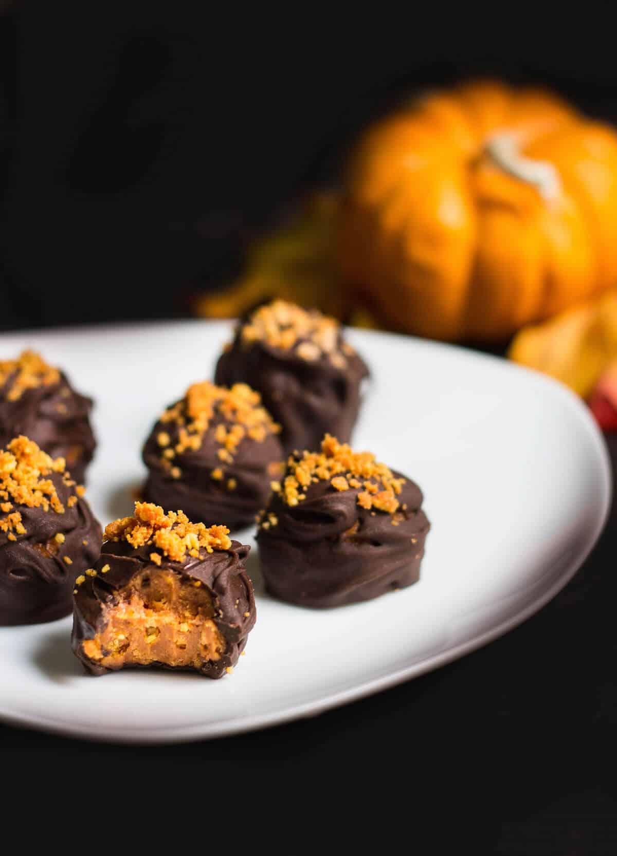 Oreo Truffles made with pumpkin spice oreos - close up shot of inside truffle