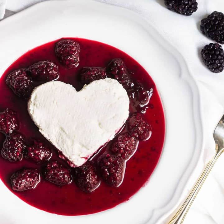 Coeur a la creme: A creamy, rich French dessert served with blackberry sauce. Perfect for Valentine's Day or special occasions! Recipe via MonPetitFour.com
