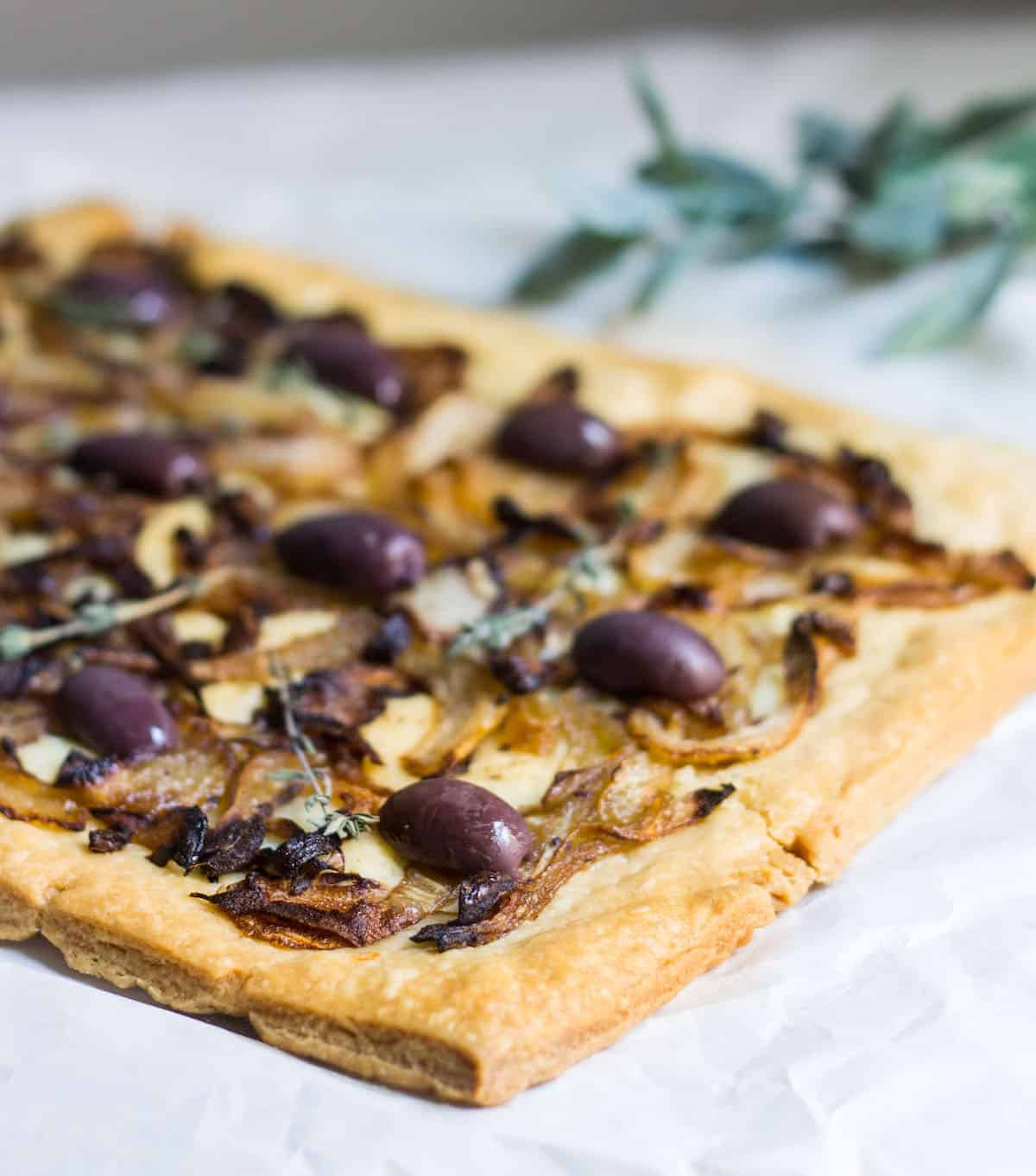 Pissaladière: French-style pizza from Nice made with anchovies, onion, and olives! Recipe via MonPetitFour.com