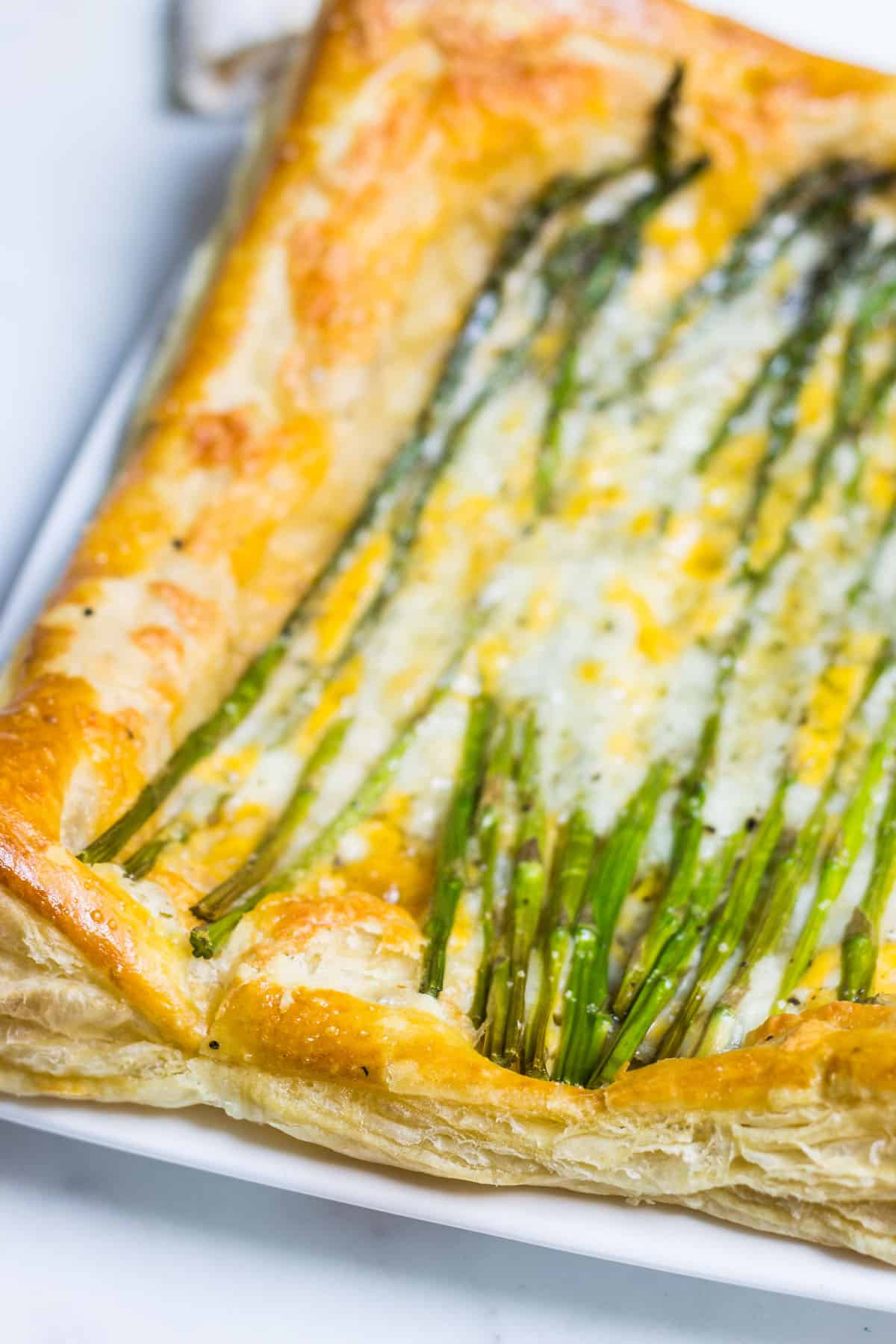 Asparagus Tart: a quick and simple appetizer or lunch using puff pastry, fresh asparagus, and cheese. Recipe via MonPetitFour.com