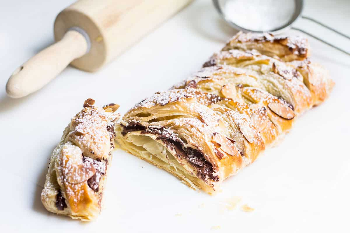 Chocolate Pastry Braid: 3-Ingredient Dessert! Gooey chocolate nestled inside puff pastry and topped with sliced almonds. Recipe via MonPetitFour.com