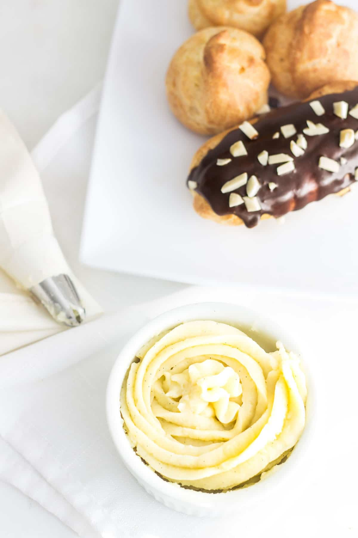 Pastry Cream (Creme Patissiere): a simple and creamy filling for tarts, cakes, and French pastries like eclairs and profiteroles! Recipe via MonPetitFour.com