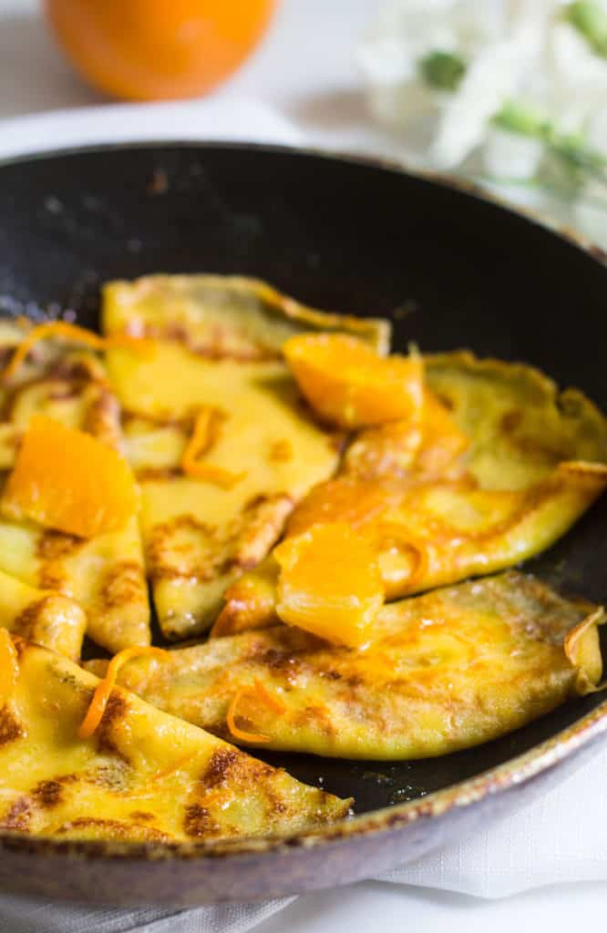 Crepes Suzette with orange sauce in a skillet