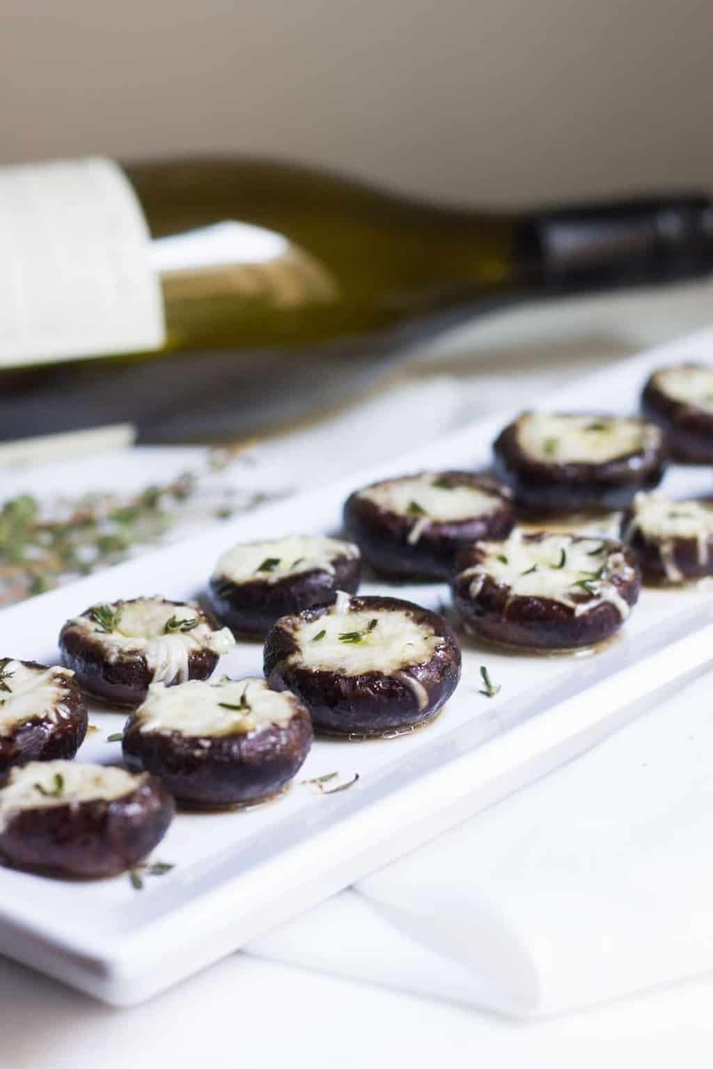 Garlic Stuffed Mushrooms: crimini mushrooms stuffed with garlic butter and parmesan cheese. Perfect appetizer or side dish! French recipe via MonPetitFour.com