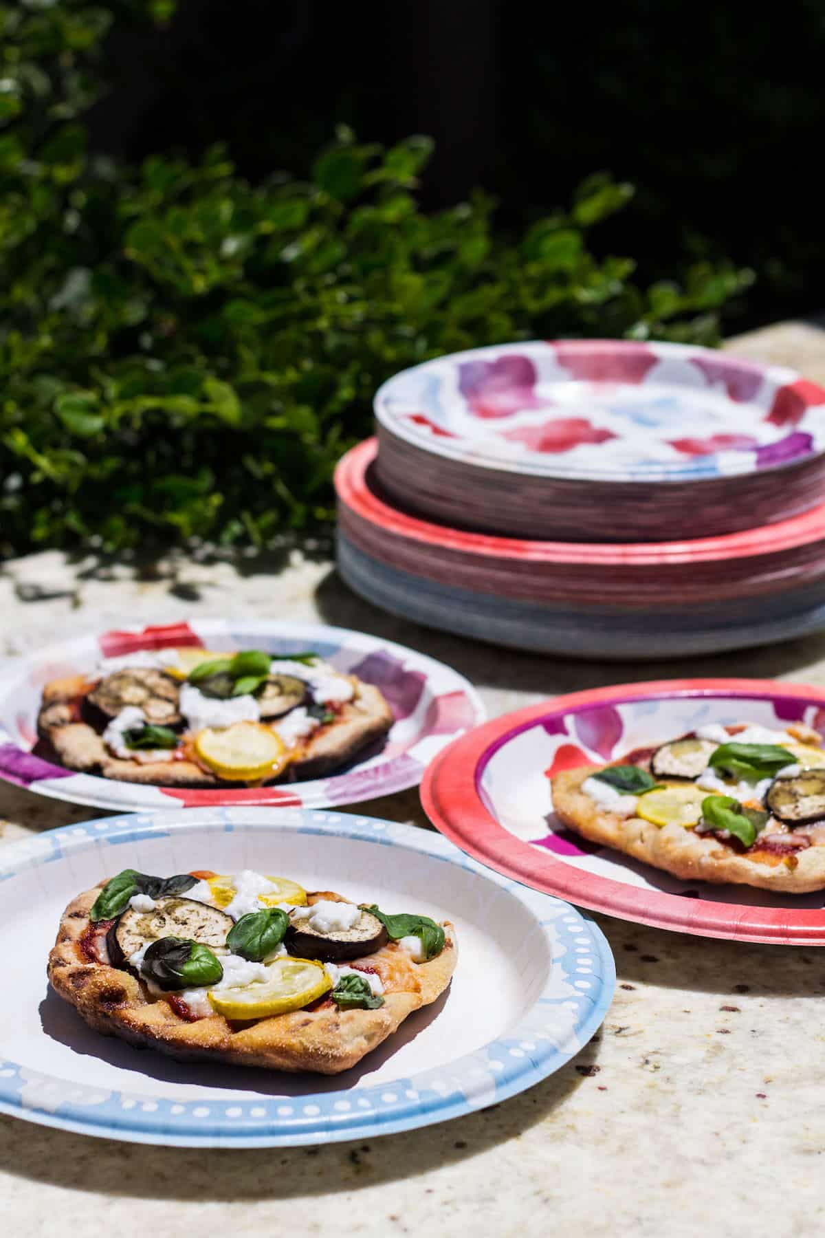 Grilled Pizza: personal size pizza made on the grill and topped with summer veggies! Recipe via MonPetitFour.com