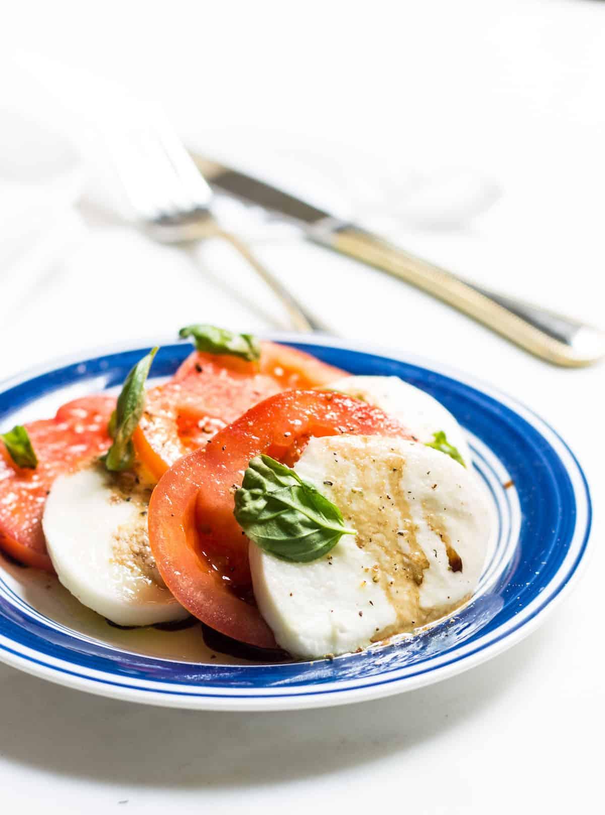 Tomato Mozzarella Salad with fresh basil! Recipe via MonPetitFour.com