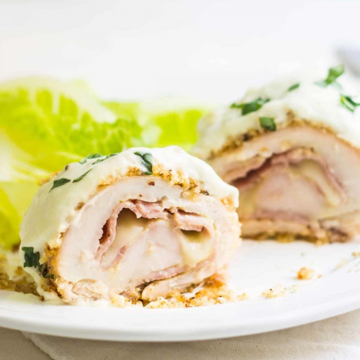 Chicken Cordon Bleu: an easy and quick French dinner! This classic is made with breaded chicken stuffed with ham and cheese. Topped with a dijon cream sauce. Recipe via MonPetitFour.com