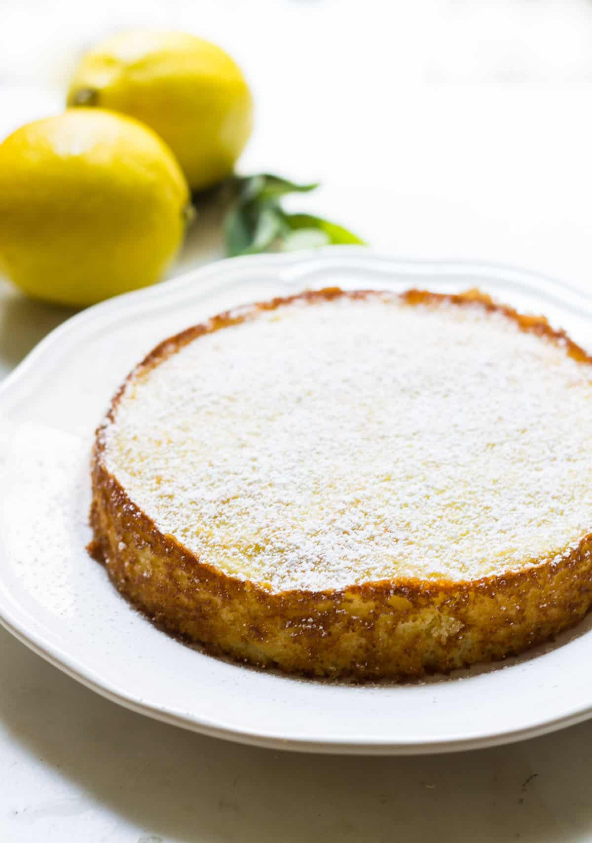 Lemon Ricotta Cake: a simple and super easy cake made with ricotta cheese and lemon. So airy and moist! Recipe via MonPetitFour.com