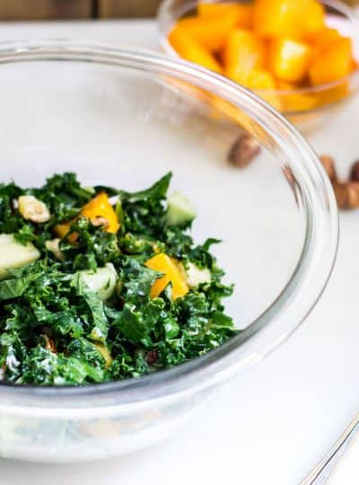 Kale Butternut Squash Salad: an easy fall salad with a tasty maple vinaigrette. Perfect for the holidays too! Recipe via MonPetitFour.com