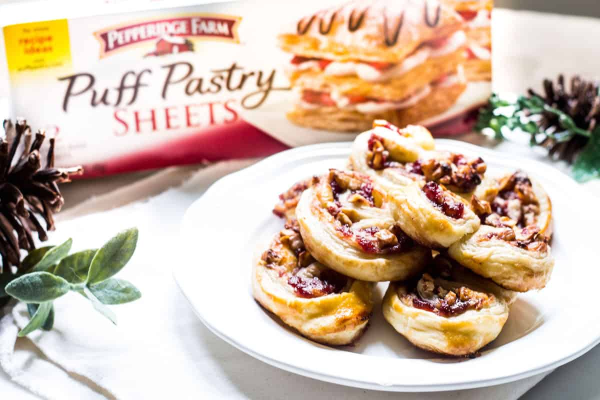 Savory Palmiers made with brie, walnuts, cranberry jelly, and Pepperidge Farm® Puff Pastry Sheets. A crowd-pleasing appetizer for any occasion or holiday! French recipe via MonPetitFour.com #ad #InspiredbyPuff