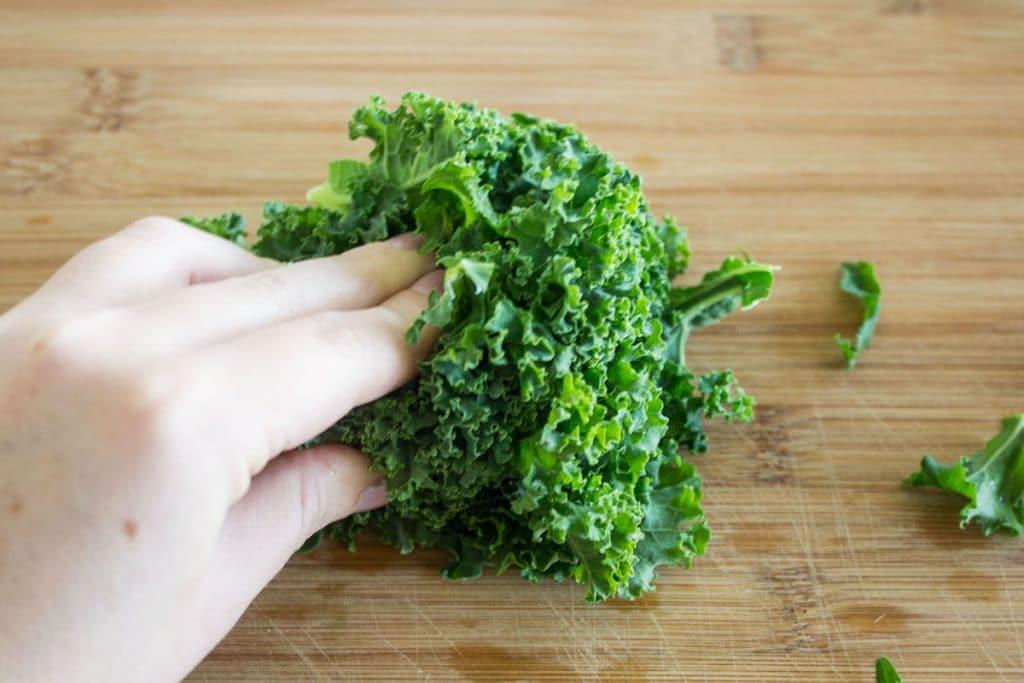 Kale Caesar Salad kale leaves get chopped