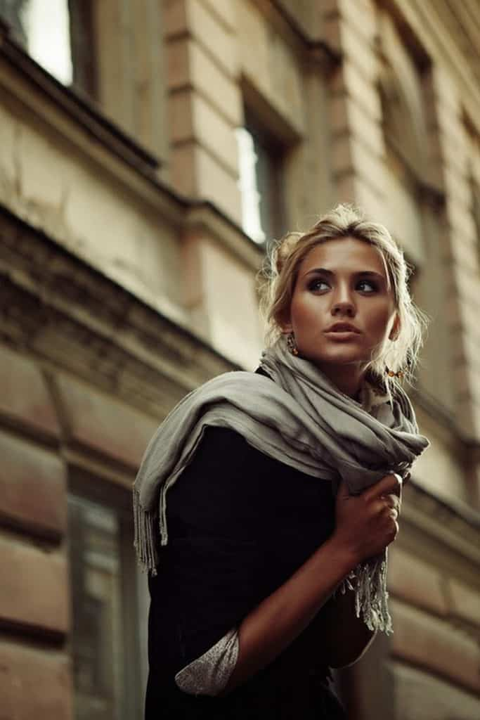 Parisian scarf tossed over one shoulder