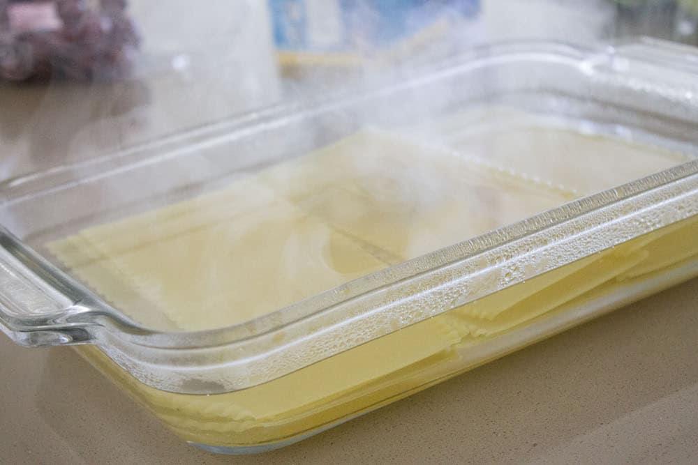 Easy Beef Lasagna pasta in hot water via Mon Petit Four