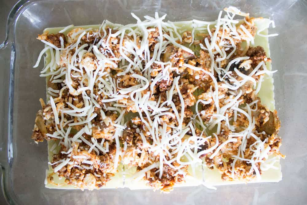 Easy beef Lasagna filling topped with cheese via Mon Petit Four