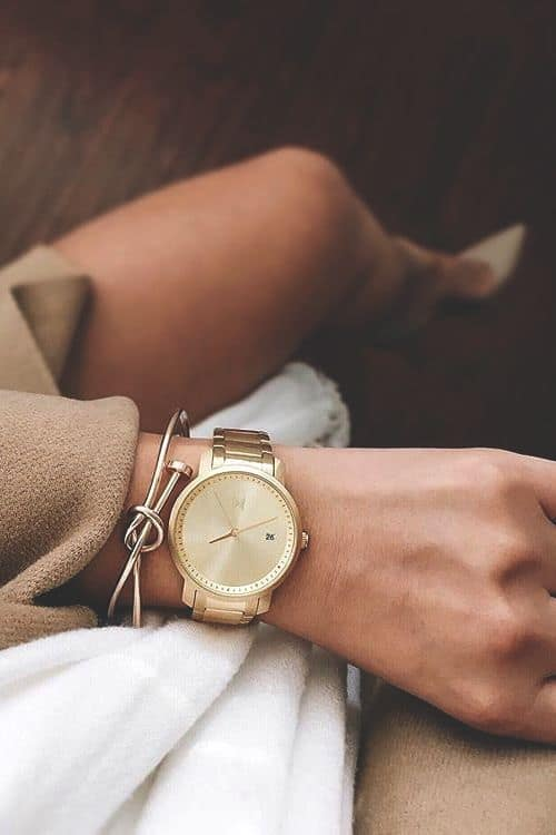 gold watch with bangles