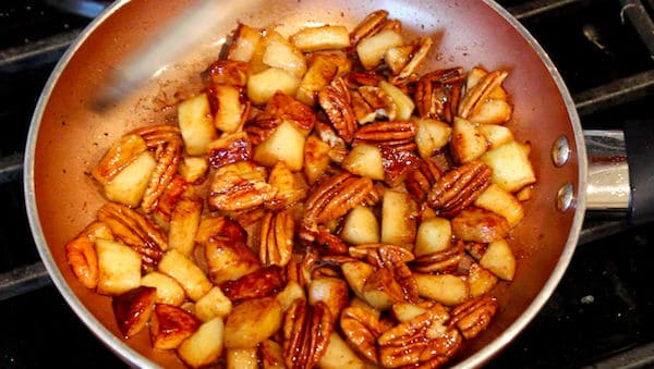 Apples and pecans cooked in butter and sugar