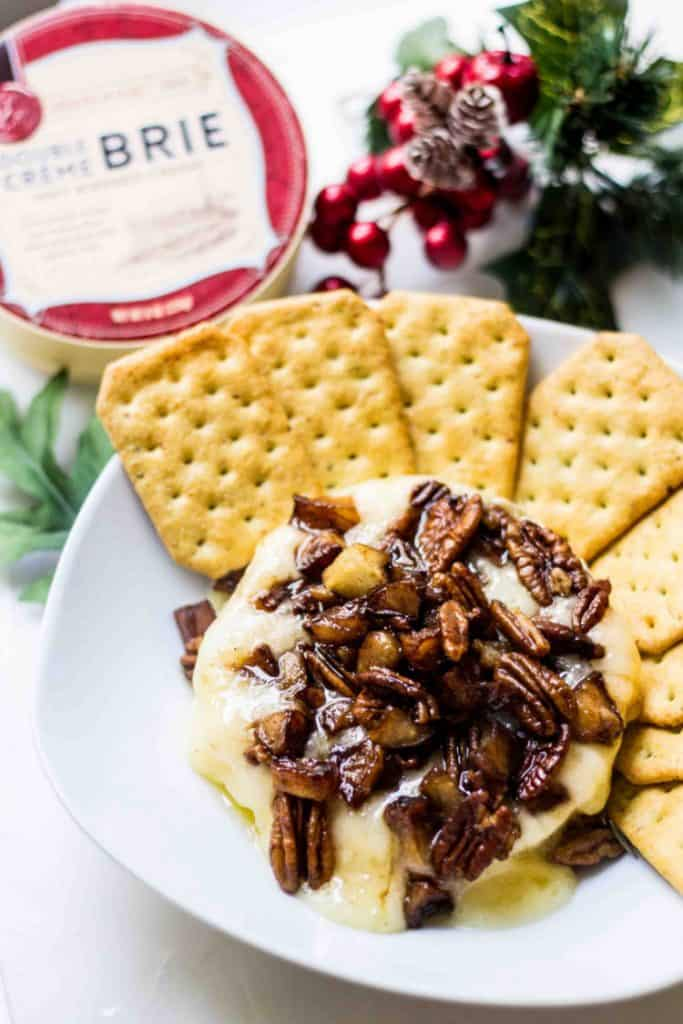 Baked Brie Recipe with apples and pecans served and served with crackers
